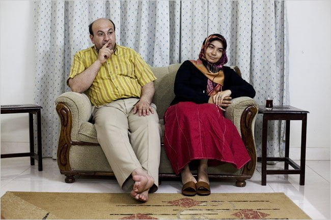 Mesut Kacmaz, principal of a PakTurk school in a poor neighborhood of Karachi, and his wife, Meral, in their home. Credit Carolyn Drake for The New York Times