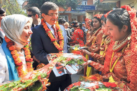 Foreign Affairs Minister Ahmet Davutoglu is with students at the Turkish School in Kathmandu, Nepal