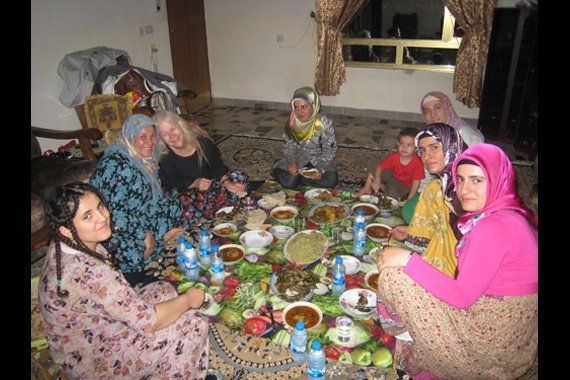 Sr. Martha Ann Kirk enjoys a feast in northern Iraq during her research study on peace building efforts by Muslims inspired by Fethullah Gülen