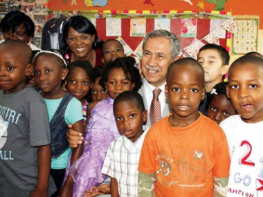 Deputy Prime Minister of Turkey, Mr. Arinc, is with students at a Turkish School in Nigeria