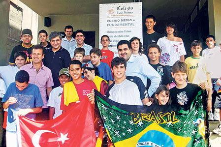 Brazil coach Dunga (2nd L, in purple shirt) at a Turkish school in Sao Paulo