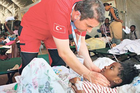 """Kimse Yok Mu, a Turkish charity organization, extended a helping hand to Haiti's quake victims by launching an aid campaign titled """"Haiti Waits for Emergency Help"""" to collect donations"""