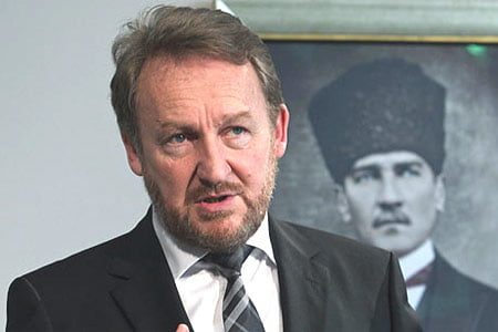 Bakir Izetbegovic speaks to the media during a joint news conference with Turkey's Foreign Minister Ahmet Davutoğlu, unseen, in Turkish capital of Ankara on Feb. 15, 2012. (Photo: AP)