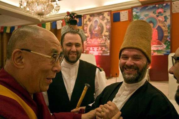 Exiled Tibetan spiritual leader the Dalai Lama talks with whirling dervishes after watching their performance during a Turkish festival in New Delhi. (Photo: Cihan, Osman Ünalan)