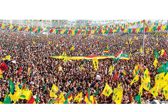 Demonstrators hold Kurdish flags in Diyarbakır on March 21, when the terrorist PKK announced a cease-fire as part of ongoing settlement negotiations. (Photo: İHA, Ahmet Ün)