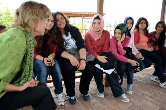 Mara Dodge, history professor at Westfield State University in Westfield, Mass., talks to a group of eighth grade students at Mehmet Ozdemir Primary School in Konya, Turkey about their hobbies and aspirations on Thursday, June 7, 2012. The ten-day TCCA Turkey trip included visits to schools and other organizations founded by followers of Turkish imam Fethullah Gulen. (Yi-Ke Peng / Times Union)