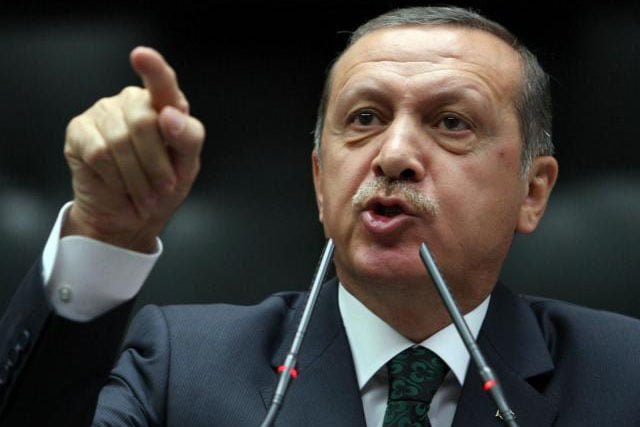 Turkish Prime Minister Tayyip Erdogan is applauded by members of parliament from his ruling Justice and Development Party (AKP) during a meeting at the Turkish parliament in Ankara June 25, 2013. (Adem Altan / AFP / Getty Images)