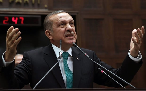 Turkey's Prime Minister Recep Tayyip Erdogan addresses his supporters at the parliament in Ankara, Turkey / Photo: AP