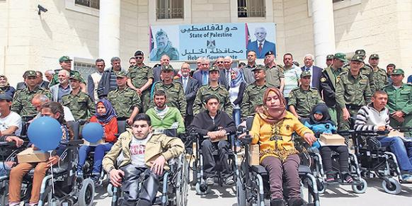 The charity Kimse Yok Mu recently delivered electric wheelchairs to 25 handicapped Palestinians in Hebron. (Photo: Cihan)