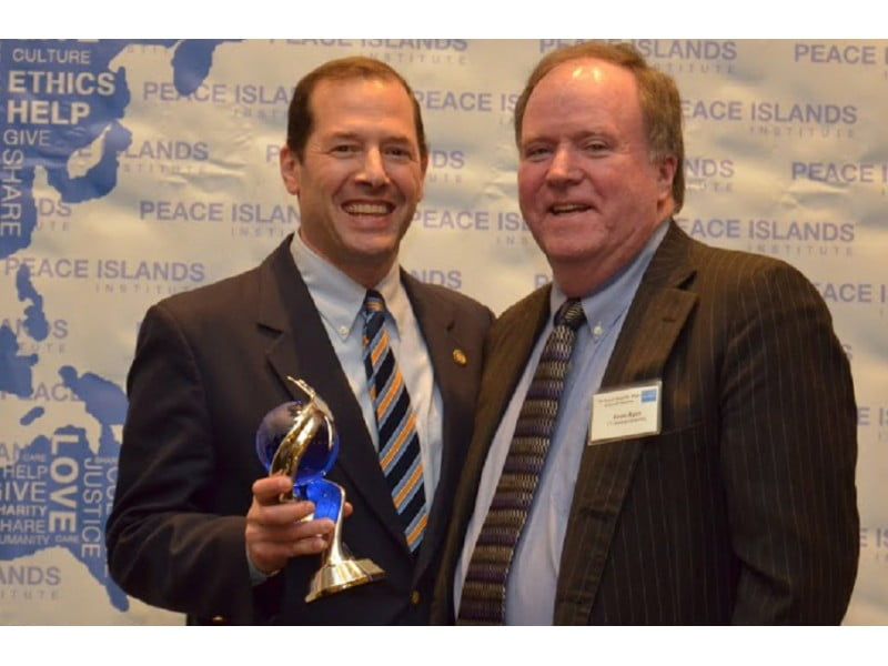 State Rep. Andy Fleischmann receives the Statesman of the Year Award standing with Rep. Kevin Ryan (right). Submitted photo