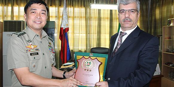 "International Turkish Schools in the Philippines General Director Malik Gence (R) received the ""Honor Award"" from Gendarmerie Command Civil Operations Commander Col. Arnulfo Marcelo B. Burgos on Gülen's behalf. (Photo: Cihan)"