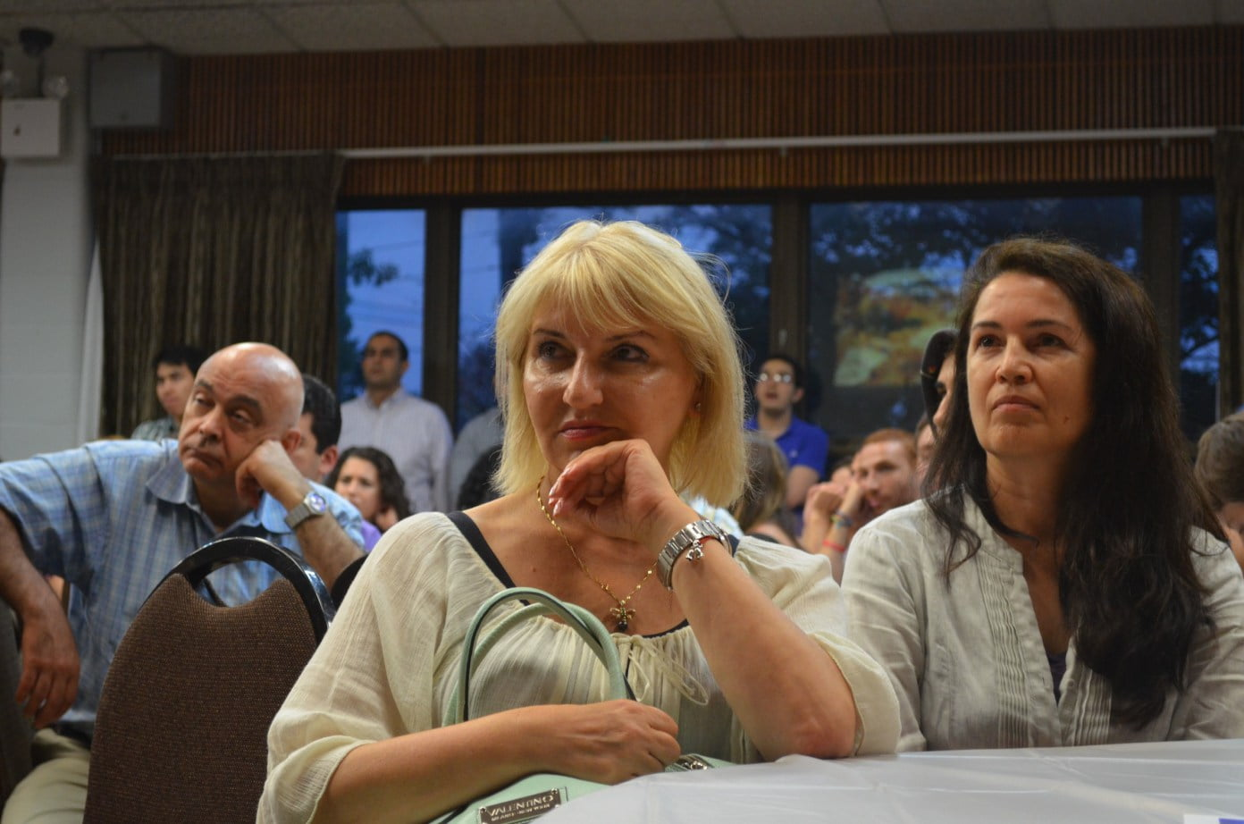 In the foreground: Polena Gillerman is Jewish and Rida Sadykova is Muslim. They are longtime friends. (Photo: Alex Ellefson / Sheepshead Bites)