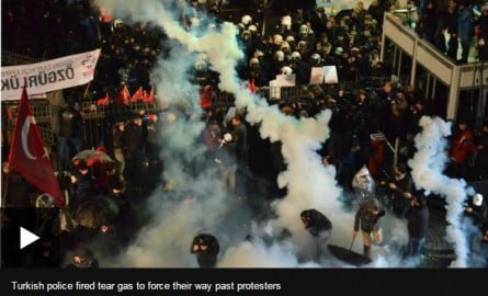 Turkish police fired tear gas to force their way past protesters