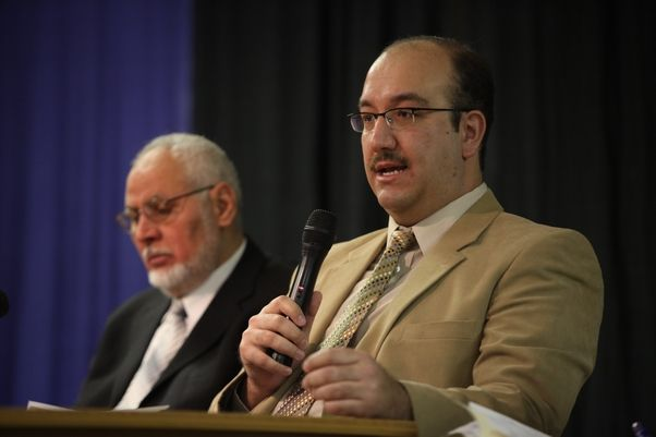 Dr. Mustafa Gokcek, Coordinator of the Middle East and Islamic studies program at Niagara University, right, speaks during a panel discussion at Niagara University in 2011. (Charles Lewis/Buffalo News)