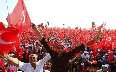 People wave national flags in Istanbul during the Democracy and Martyrs Rally organised by Turkish President Tayyip Erdogan and supported by the ruling AK Party, opposition Republican People's Party and Nationalist Movement Party. Picture: REUTERS/UMIT BEKTAS
