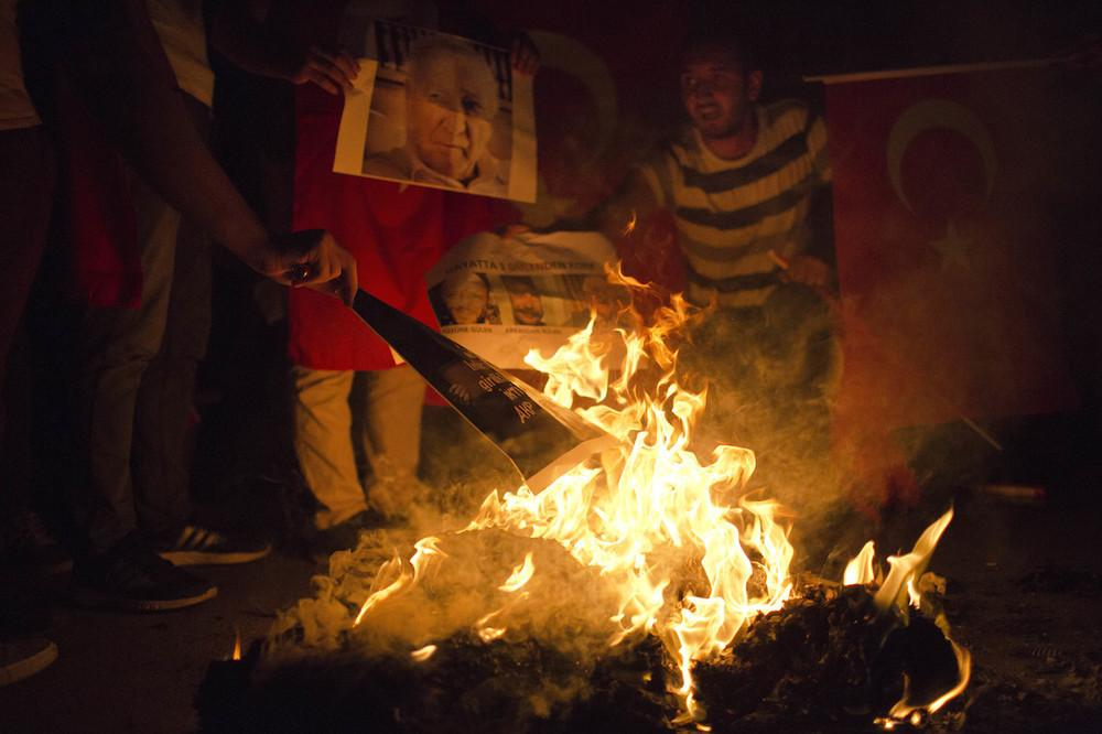 Government supporters burn photos of Fethullah Gulen, who they believe organized the coup. Petros Giannakouris / AP