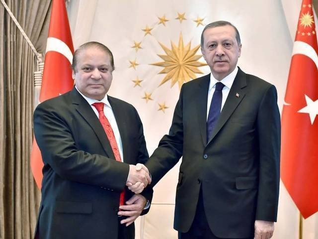 Prime Minister Nawaz Sharif shaking hands with Turkish President Recep Tayyip Erdogan. PHOTO: APP