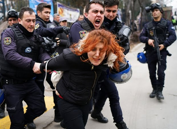Riot police detain a demonstrator during a protest against the dismissal of academics from universities following a post-coup emergency decree, outside the Cebeci campus of Ankara University in Ankara, Turkey, February 10, 2017. REUTERS/Umit Bektas