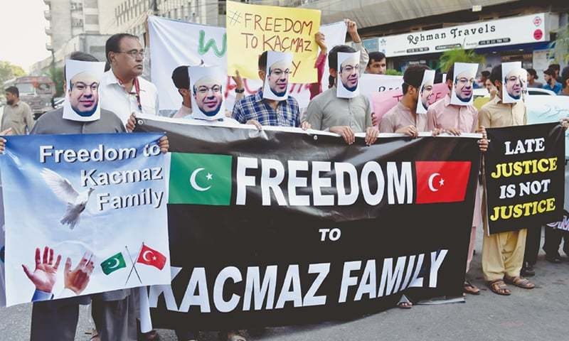 STAFF members of Pak-Turk School's campus in Karachi on Saturday stage a protest demonstration outside the Karachi Press Club for the recovery of the Kacmaz family, who were recently picked up in Lahore and taken away to an unknown location. —Fahim Siddiqi / White Star