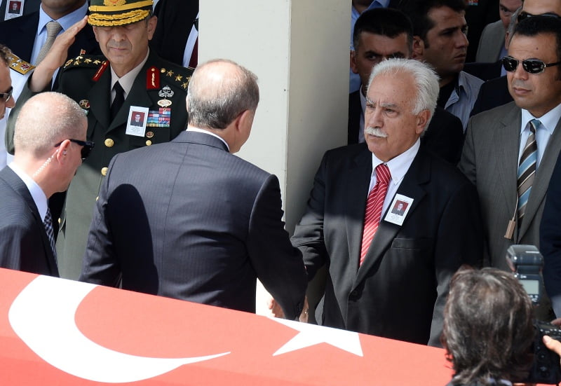 Erdogan shoke hands with Dogu Perincek - a controversial Turkish politician who has allegedly massive networks in Turkish judiciary and military, during a martyr funeral.