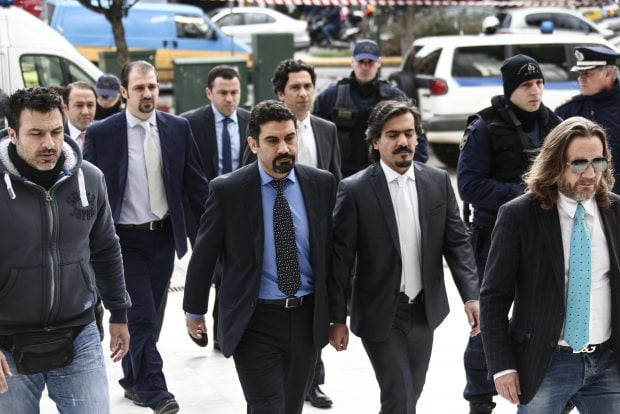 FILE - Turkish military officers (C) escorted by Greek police officers, arrive at the Supreme Court in Athens. (AP Photo/Yorgos Karahalis, FILE)